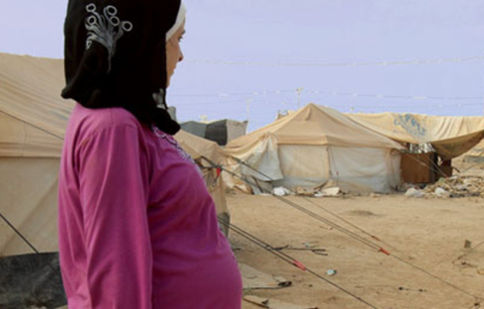 reputable site a4cdb eb71f A pregnant refugee from the violence in Syria surveys the camp where her  baby will soon be born.Photo  Raed Addayleh